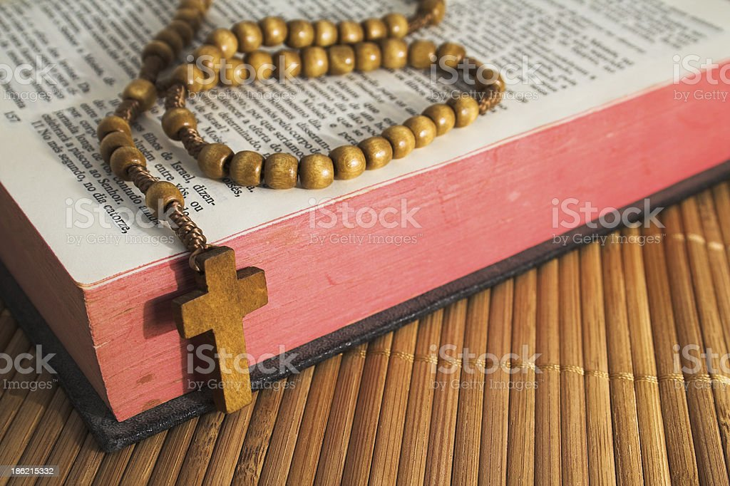 Bible with rosaries-beads crucifix stock photo