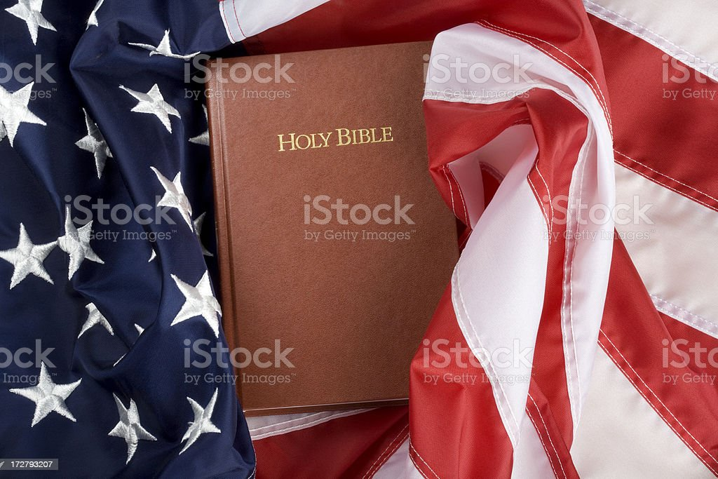 Bible wrapped in US flag stock photo