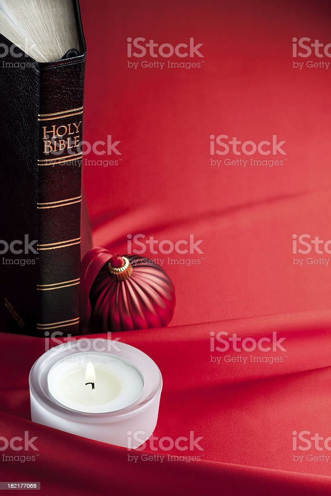 Bible, xmas bauble and candle light royalty-free stock photo