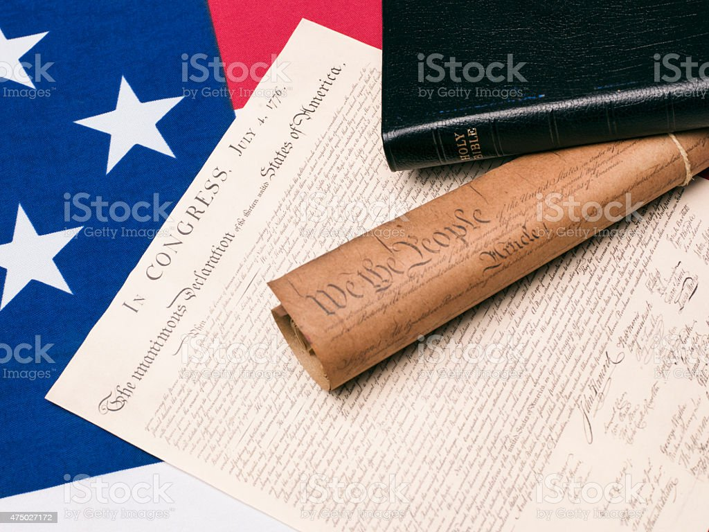 Bibles And US Constitution Documents On American Flag stock photo
