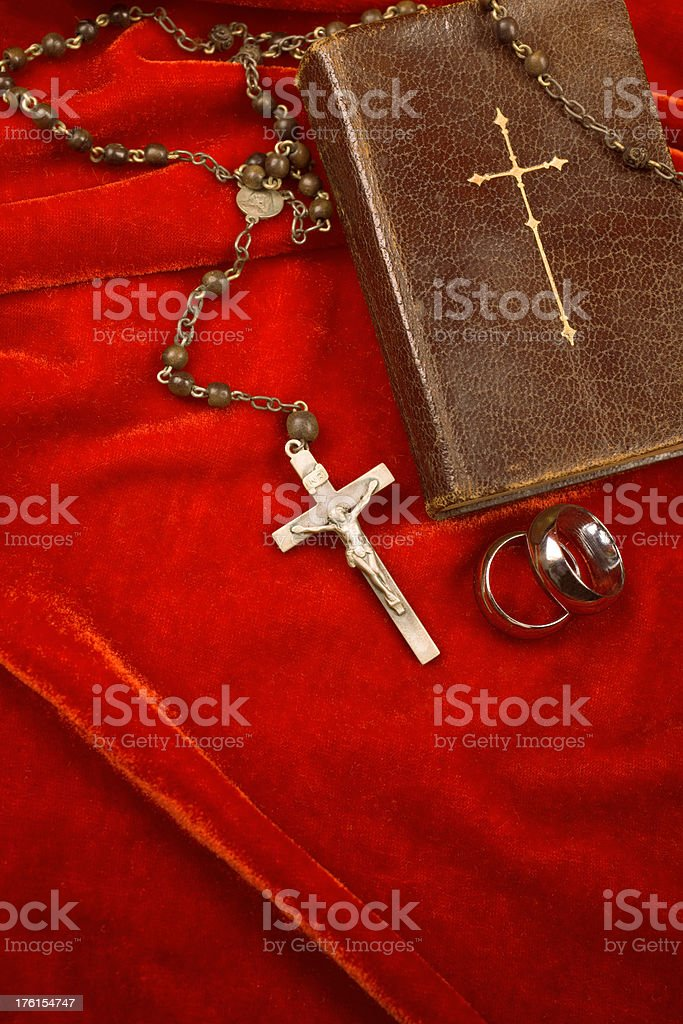 'Biblical Marriage, bible, wedding rings and crucifix' stock photo