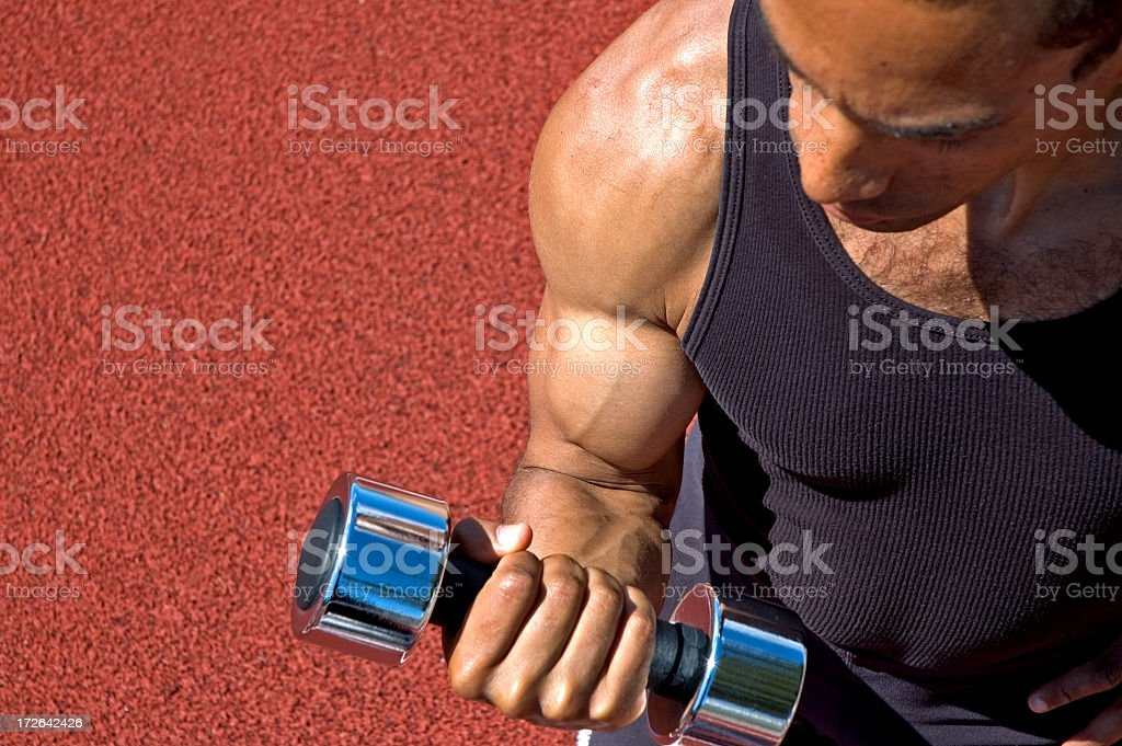 Bicep curls outdoors royalty-free stock photo