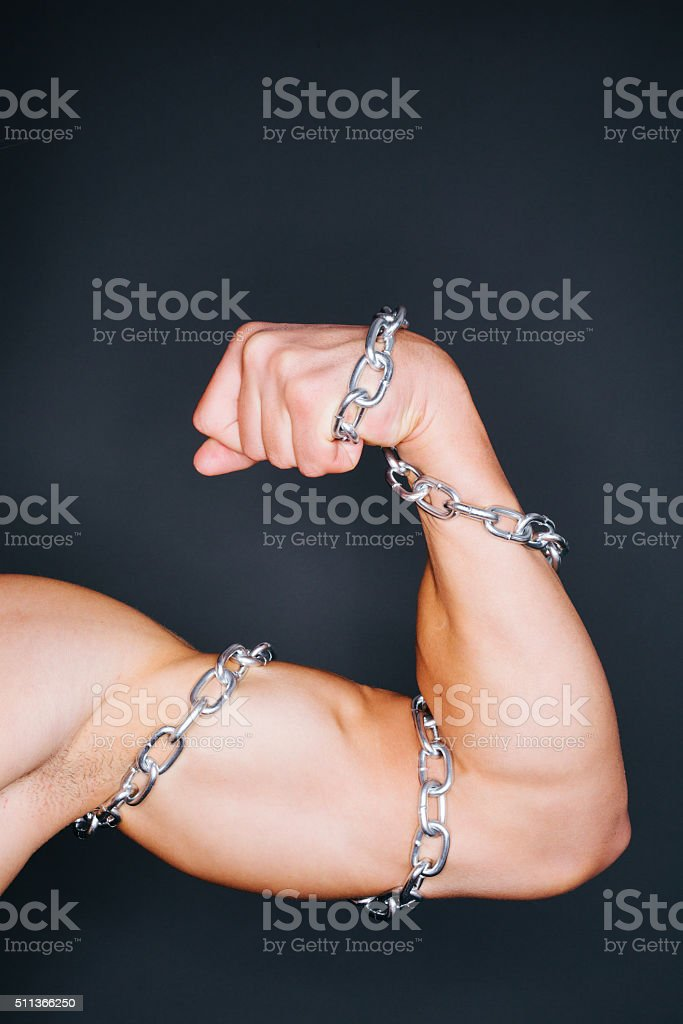 Biceps and chains stock photo
