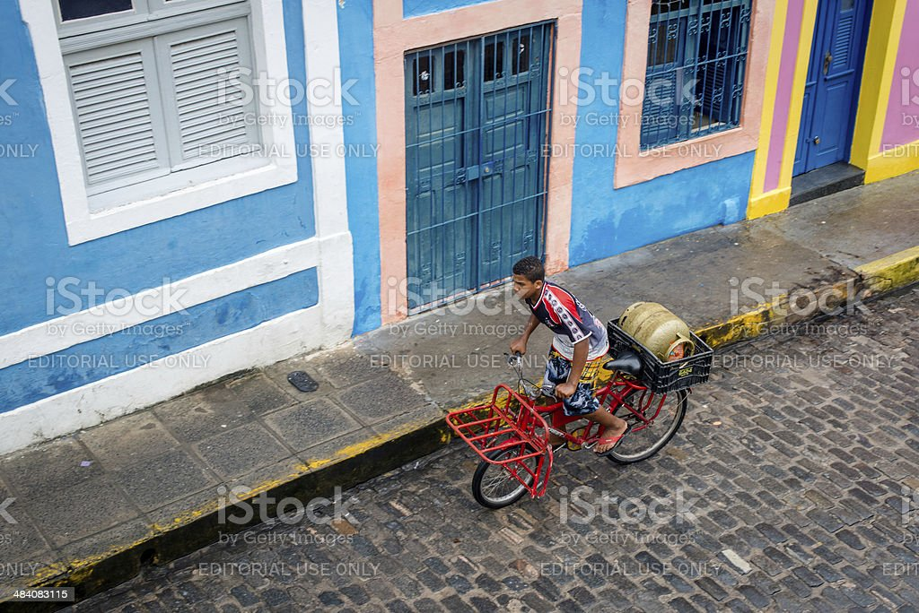 Bicicling with propane tank in Brazil royalty-free stock photo