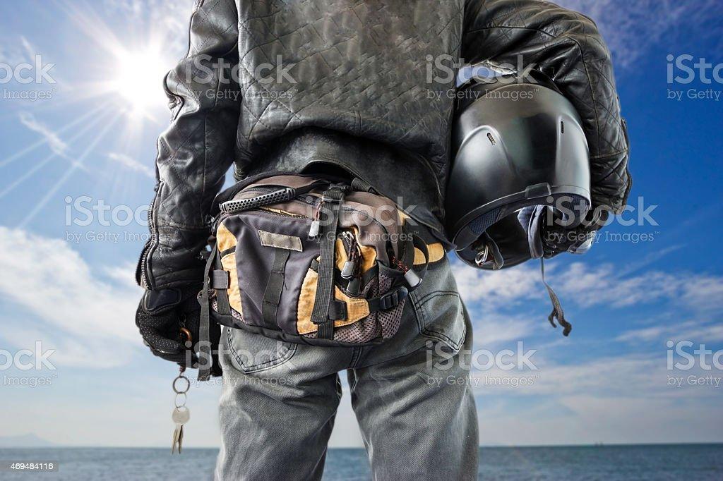 Bicker holding his crash helmet stock photo
