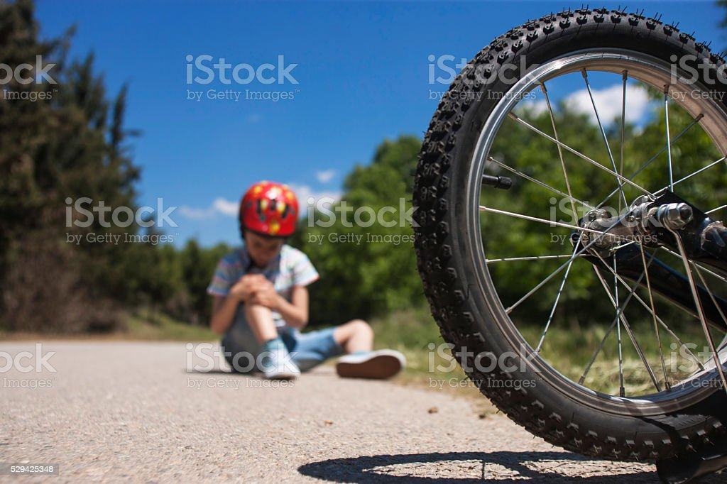Bicycle accident. Kids safety concept stock photo