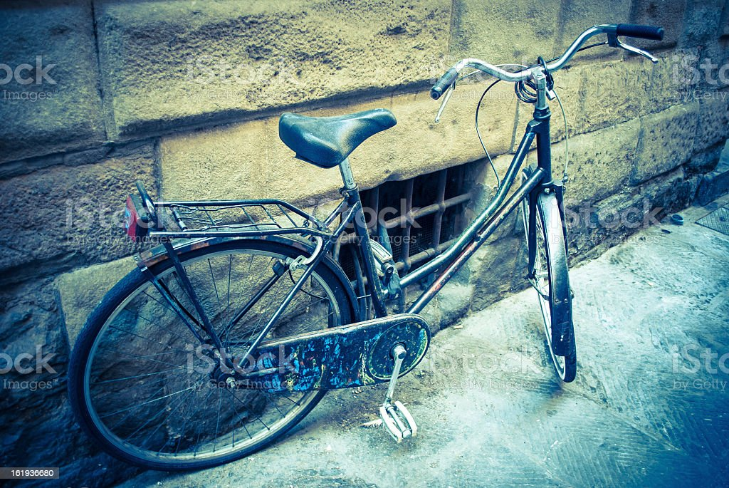 Bicycle against a wall in Florence, Italy royalty-free stock photo