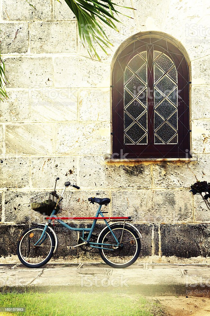 bicycle against wall royalty-free stock photo