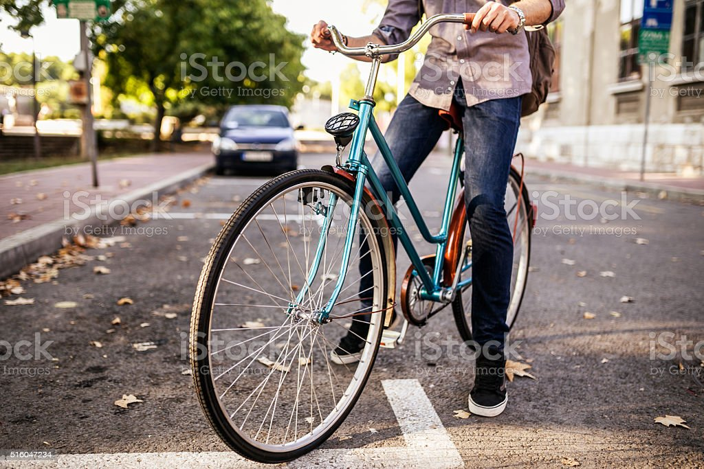 Bicycle and man's leg. No facial recognition stock photo