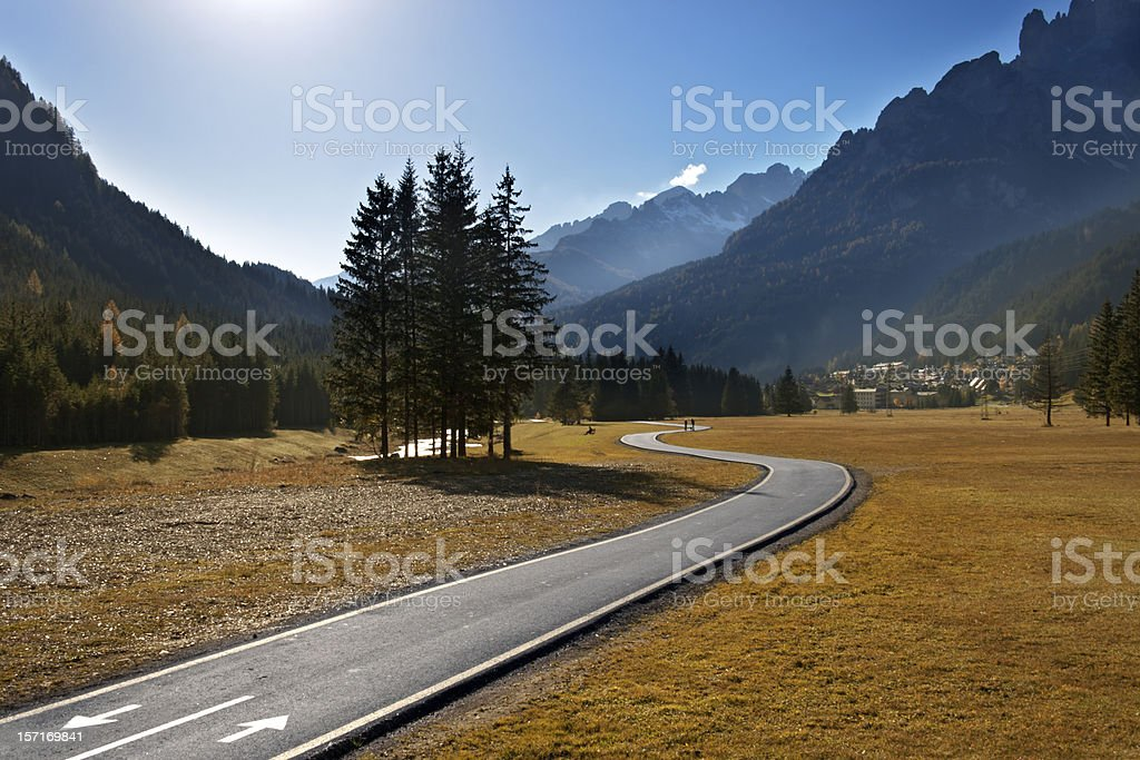 Bicycle and pedestrian lane in autumn stock photo