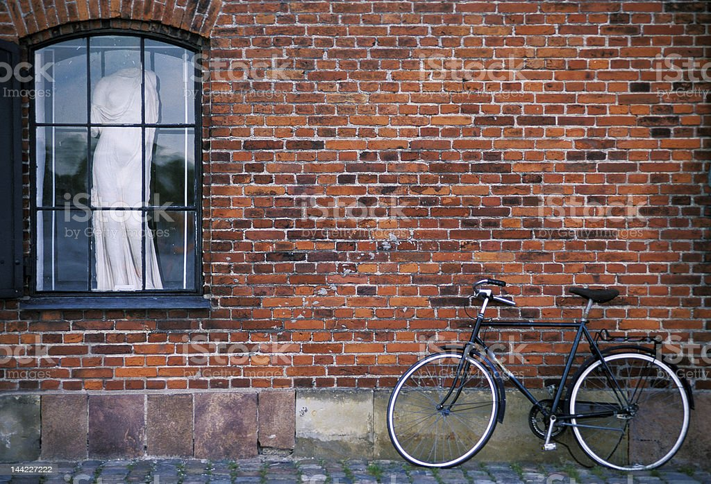 Bicycle and statue royalty-free stock photo