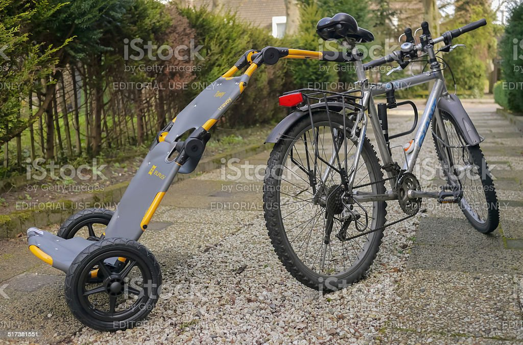 Bicycle and trailer on a driveway royalty-free stock photo