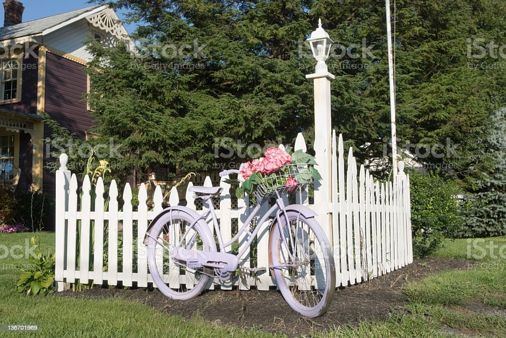 Bicycle and White Picket Fence Outdoor Yard Decoration royalty-free stock photo