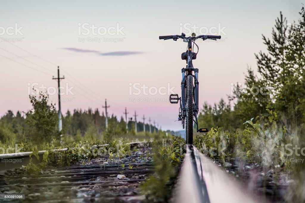 bicycle by the train railways. stock photo