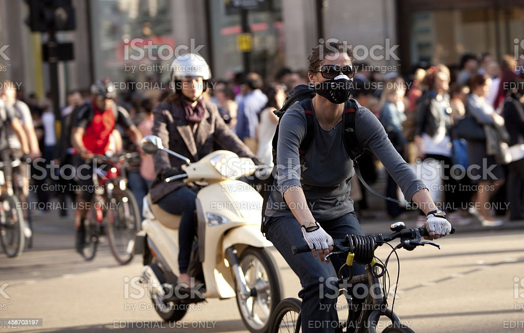Bicycle commuter wearing a mask for pollution protection stock photo