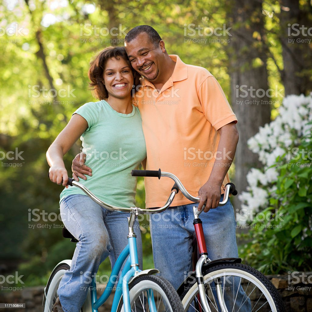 Bicycle Couple in Park stock photo