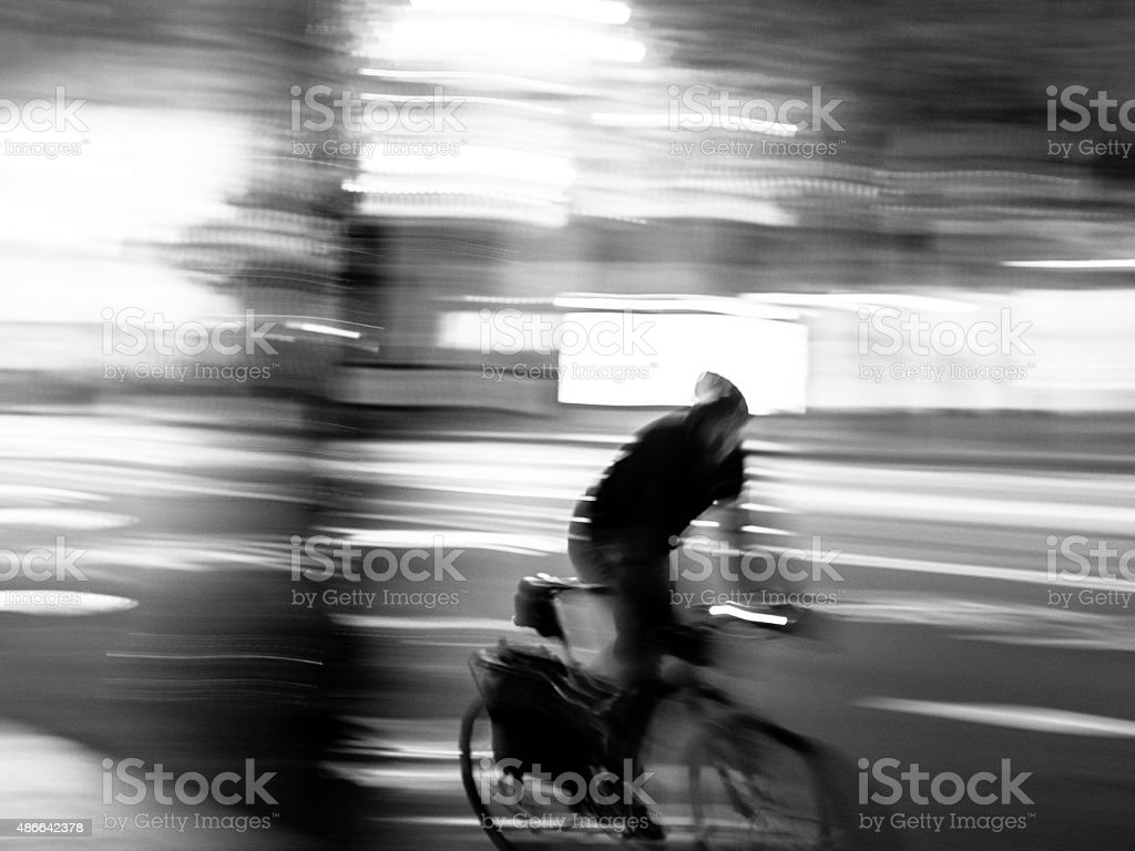 Bicycle Courier at Night stock photo