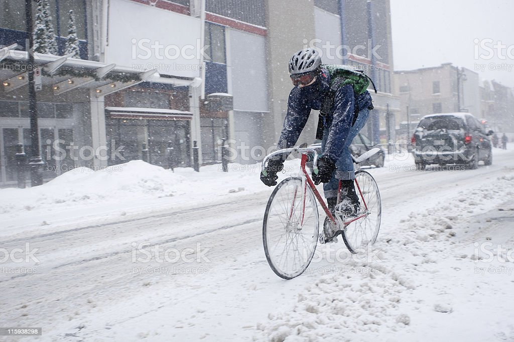 Bicycle Courier in Montreal during a blizzard stock photo