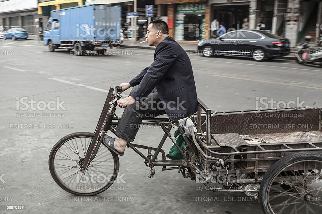 Bicycle delivery man in China stock photo