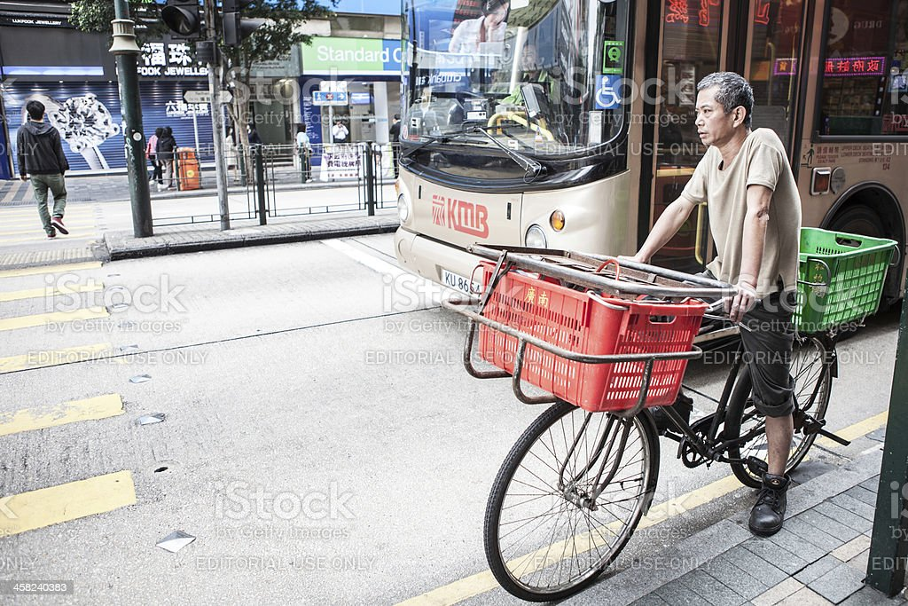 Bicycle delivery man in Hong Kong stock photo