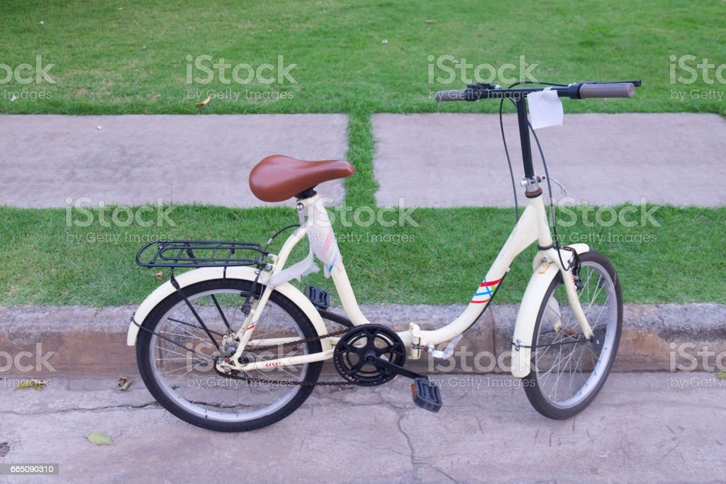 Bicycle for kids outdoors in public park stock photo