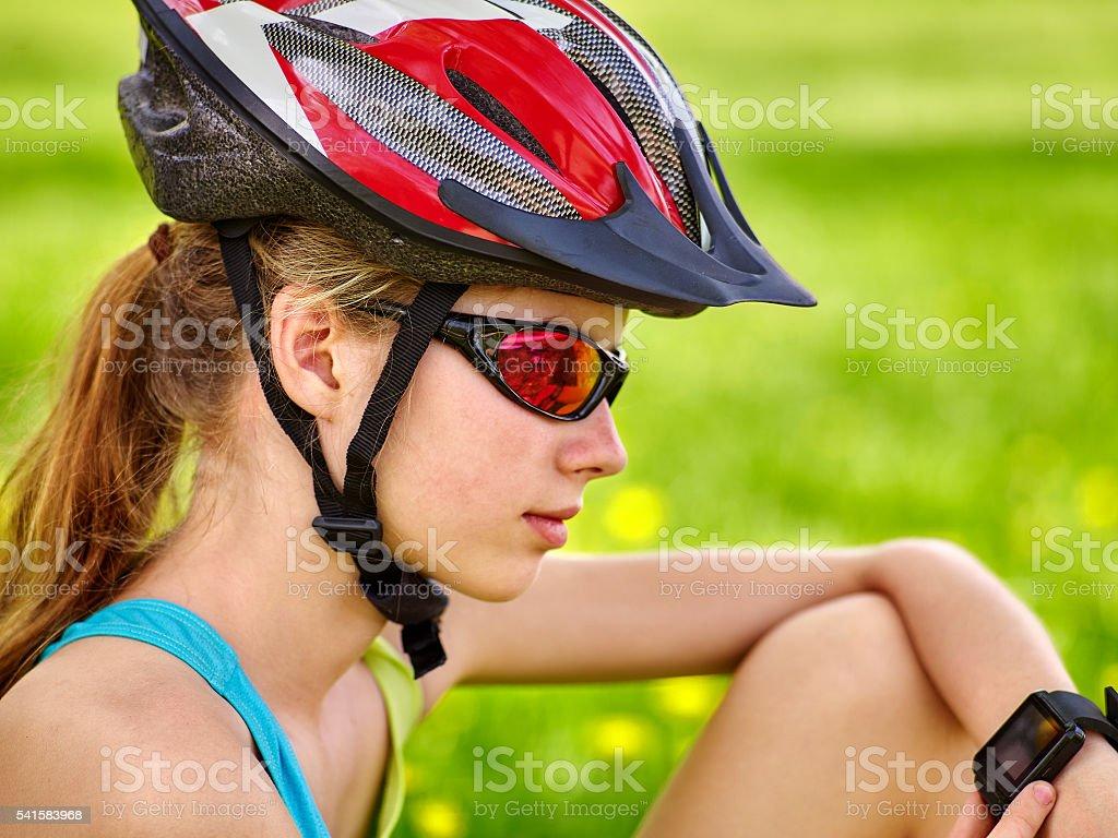 Bicycle girl looks on smart watch. stock photo