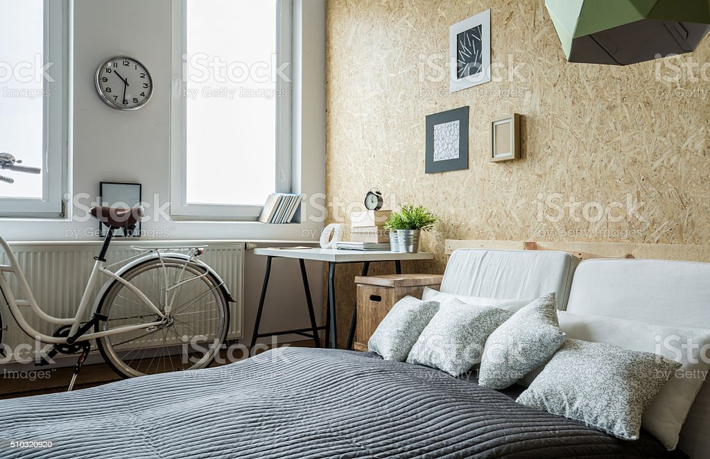 Bicycle in bedroom stock photo