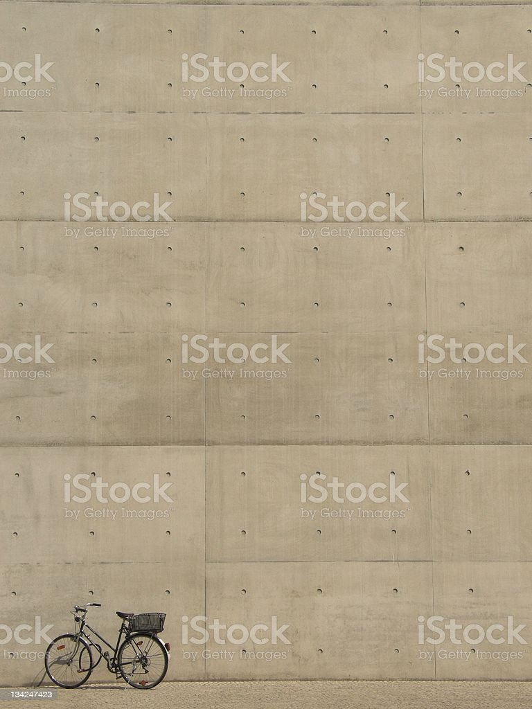 Bicycle in front of concrete wall royalty-free stock photo