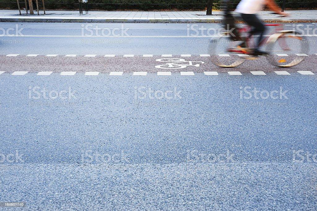 Bicycle in motion, bike lane, profile royalty-free stock photo