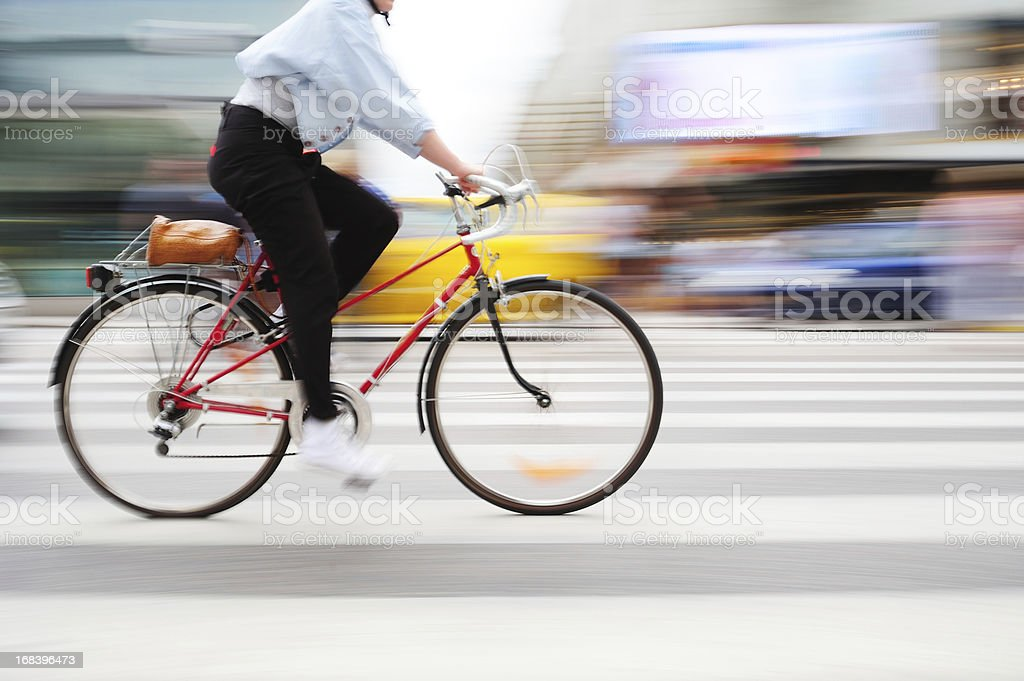Bicycle in motion on zebra crossing stock photo