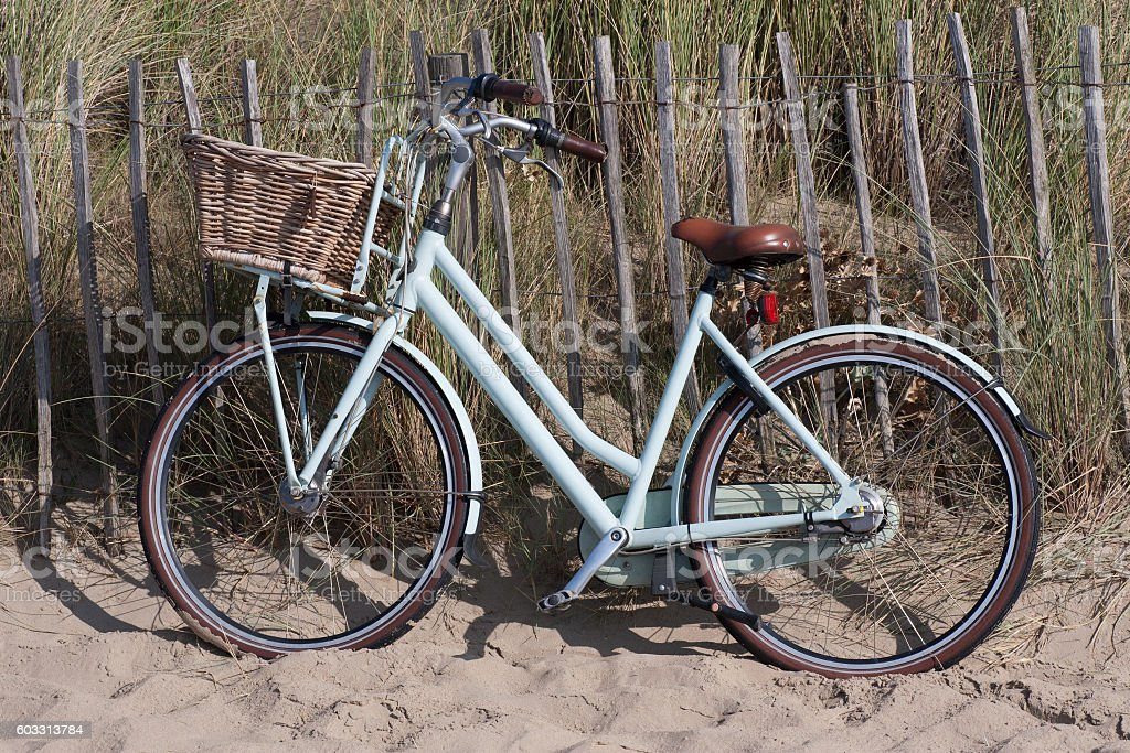 Bicycle in the dune stock photo