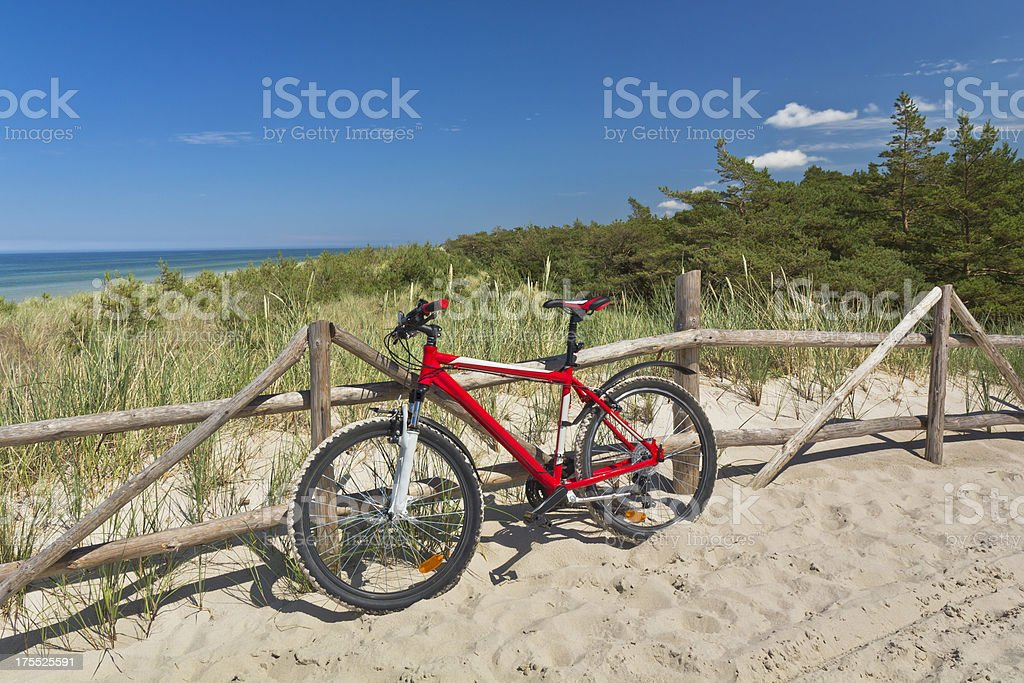 Bicycle in the sand path on dunes stock photo