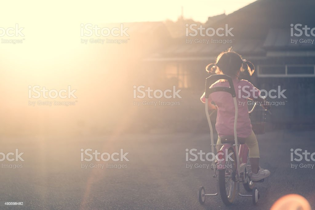 Bicycle kid of the sunset stock photo