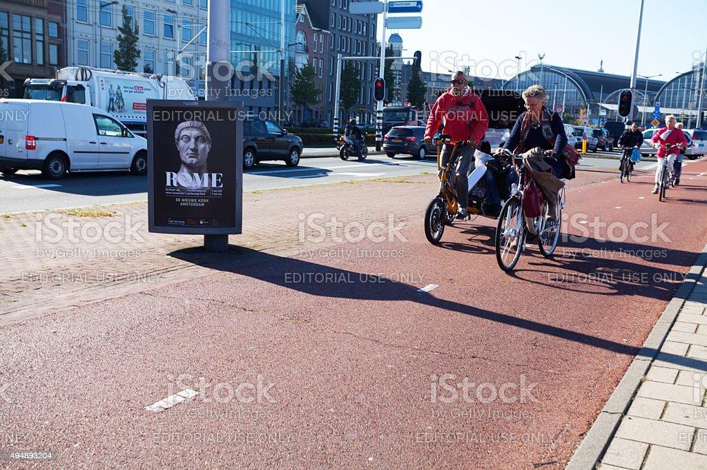 Bicycle lane and cyclist on Piet Heinkade stock photo