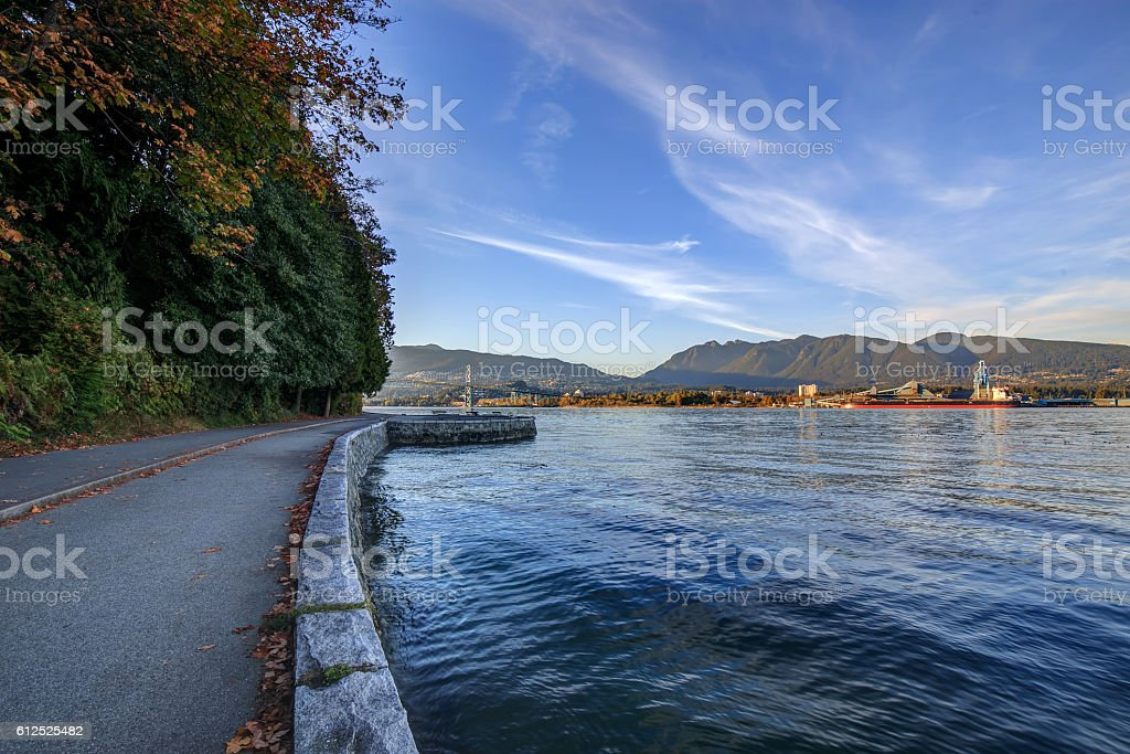 Bicycle lane and pedestrian lane along the sea wall stock photo