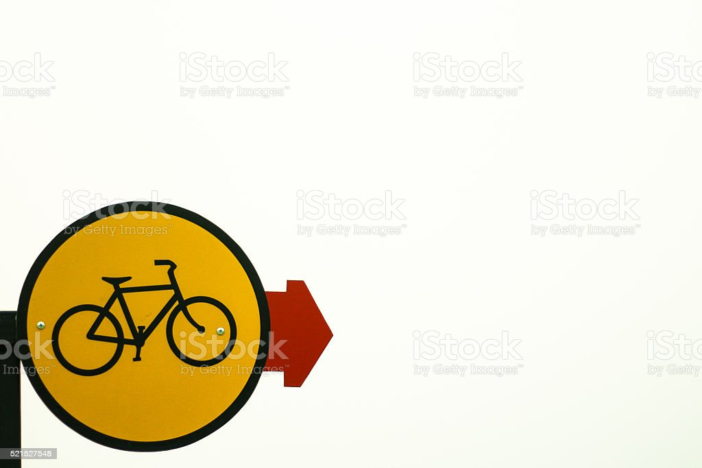 Bicycle lane sign with red indicating arrow stock photo