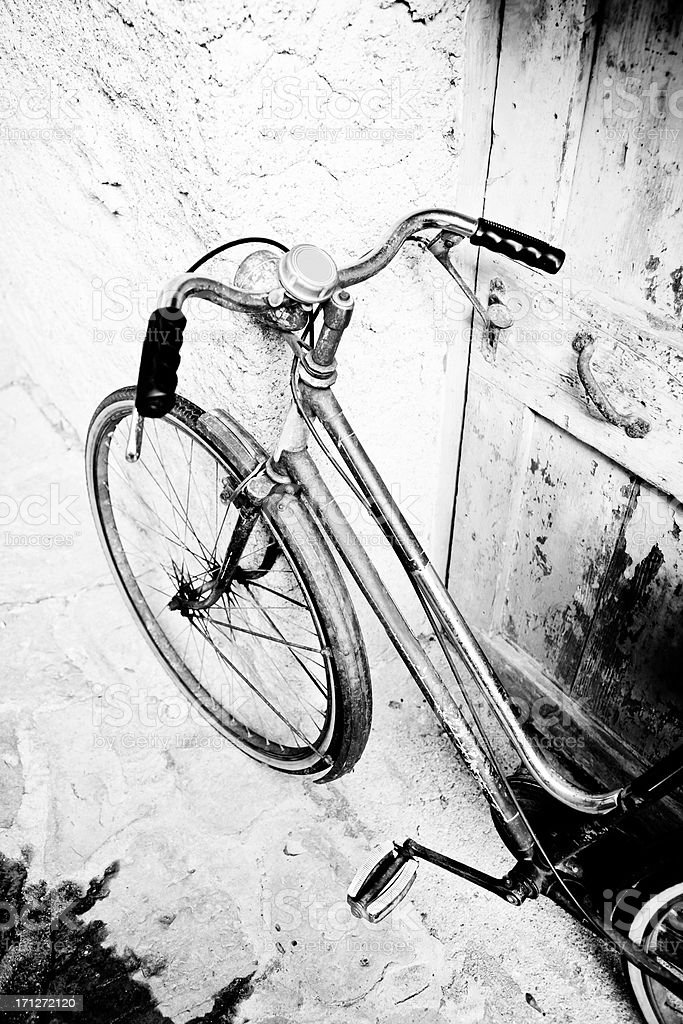 Bicycle Leaning Against Wall on Italian Street stock photo