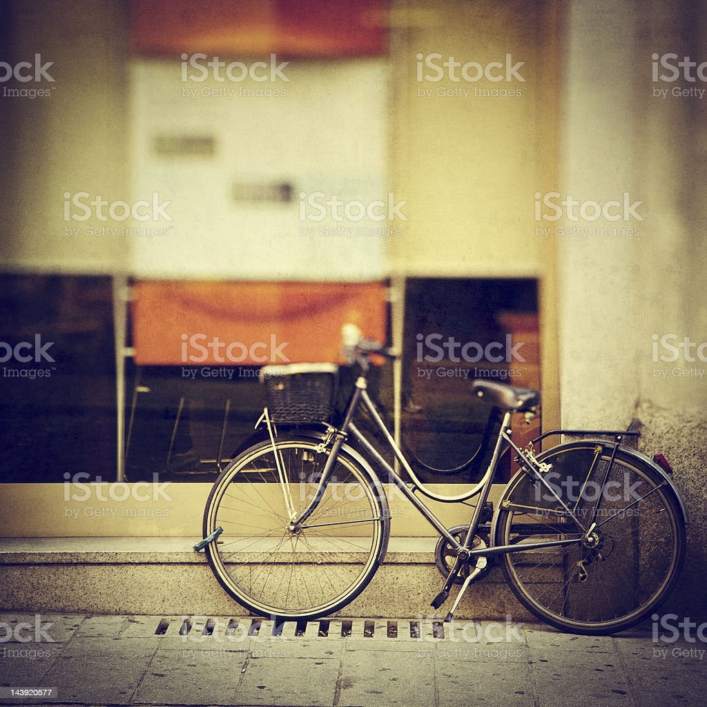 Bicycle leaning against wall royalty-free stock photo