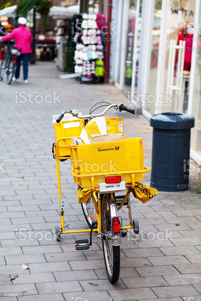 Bicycle of German Deutsche Post stock photo