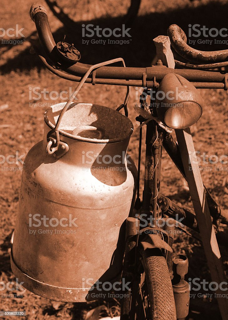 bicycle of the last century used to transport the milk stock photo