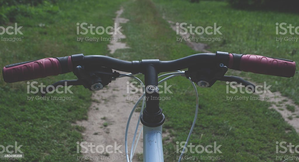 Bicycle on country road stock photo