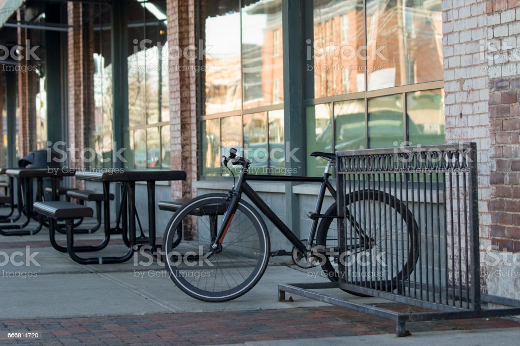 Bicycle on Rack at a Restaurant stock photo