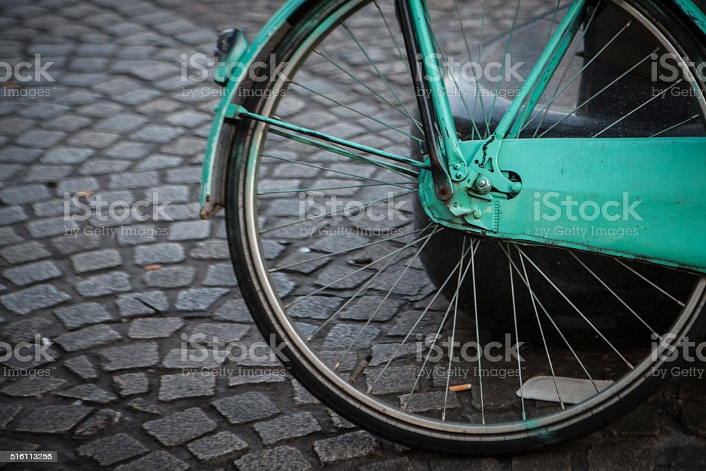 bicycle on stone block road stock photo