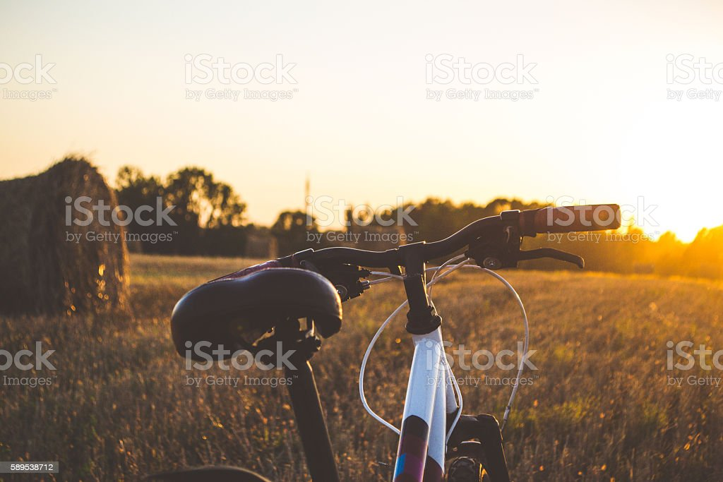 Bicycle on the road in the sun stock photo