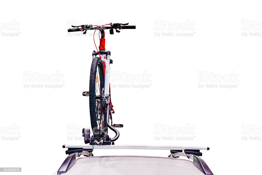 Bicycle on the roof of the car. stock photo