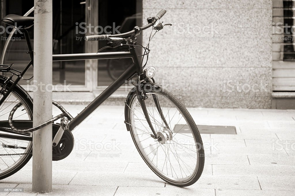 Bicycle on the sidewalk, bicycle lock. stock photo