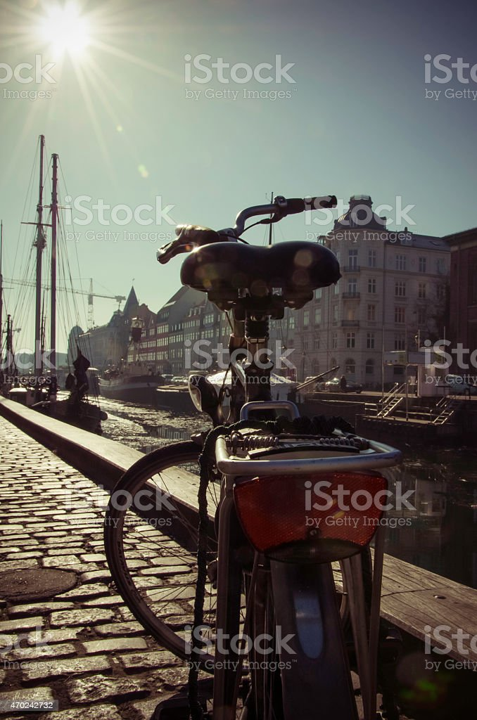 Bicycle overlooking Nyhavn under the sun stock photo