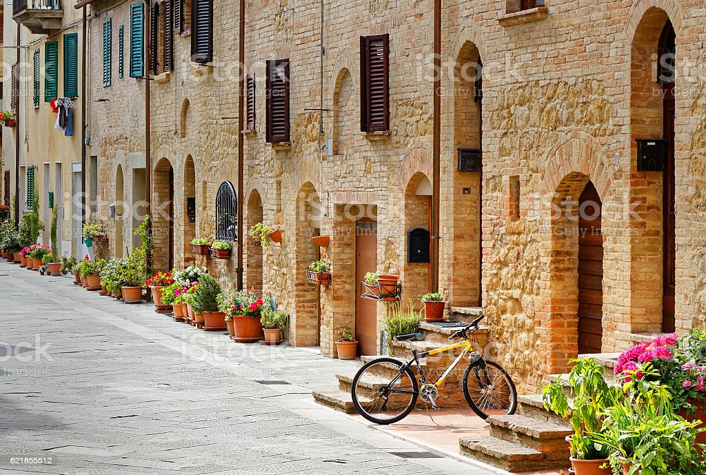 Bicycle parked in an alley in Pienza (Tuscany) stock photo