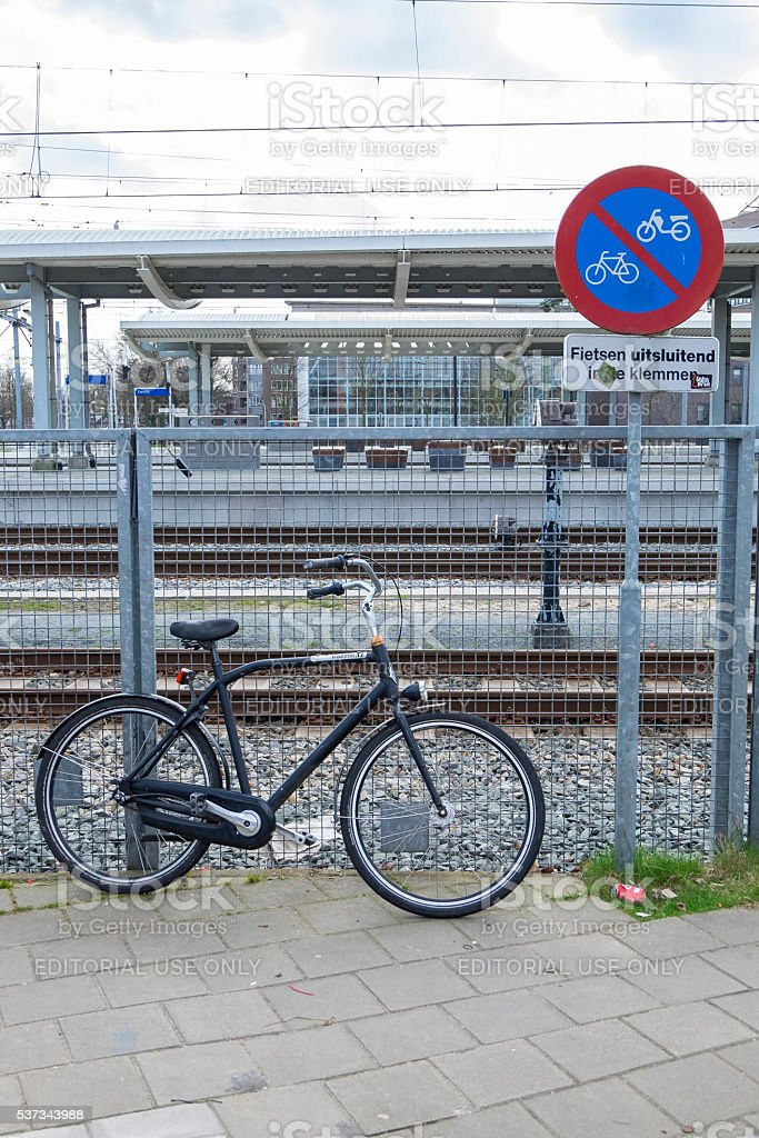 Bicycle parked next to a no parking sign in Holland stock photo