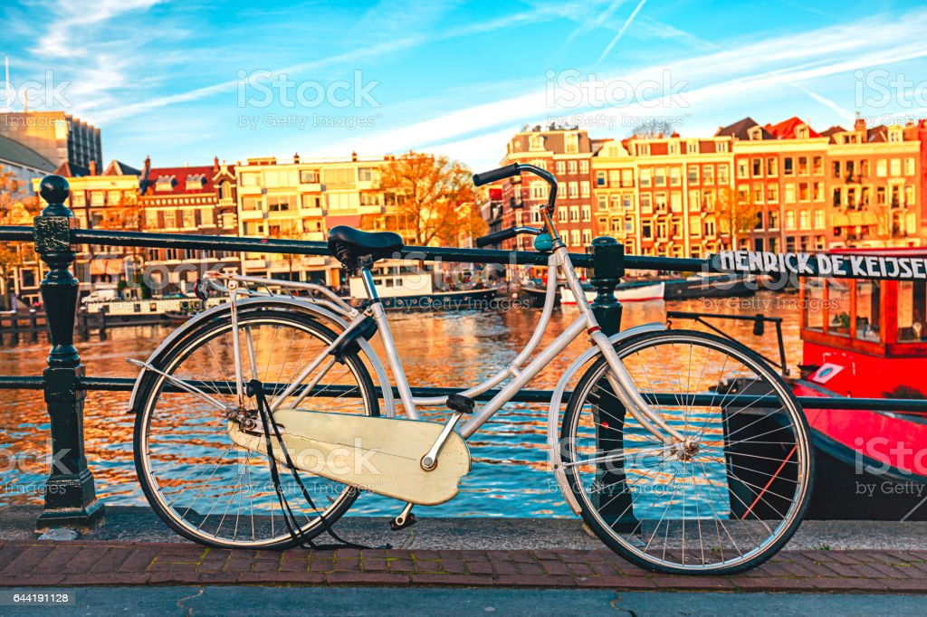 Bicycle parked on a bridge in Amsterdam stock photo